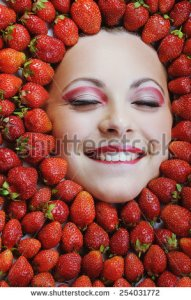 stock-photo-young-girl-beauty-face-with-red-ripe-fresh-strawberries-254031772
